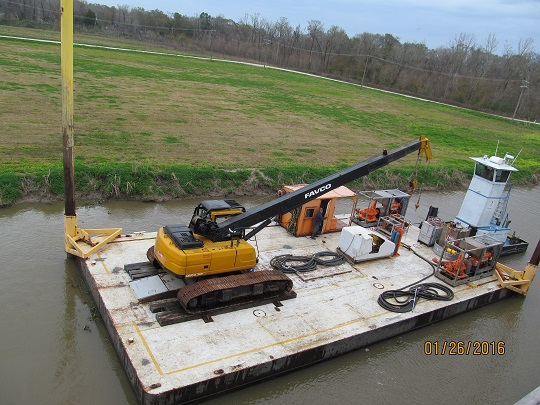 Spud barge with crane